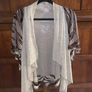 Flowy, sheer and trendy browns and cream tunic